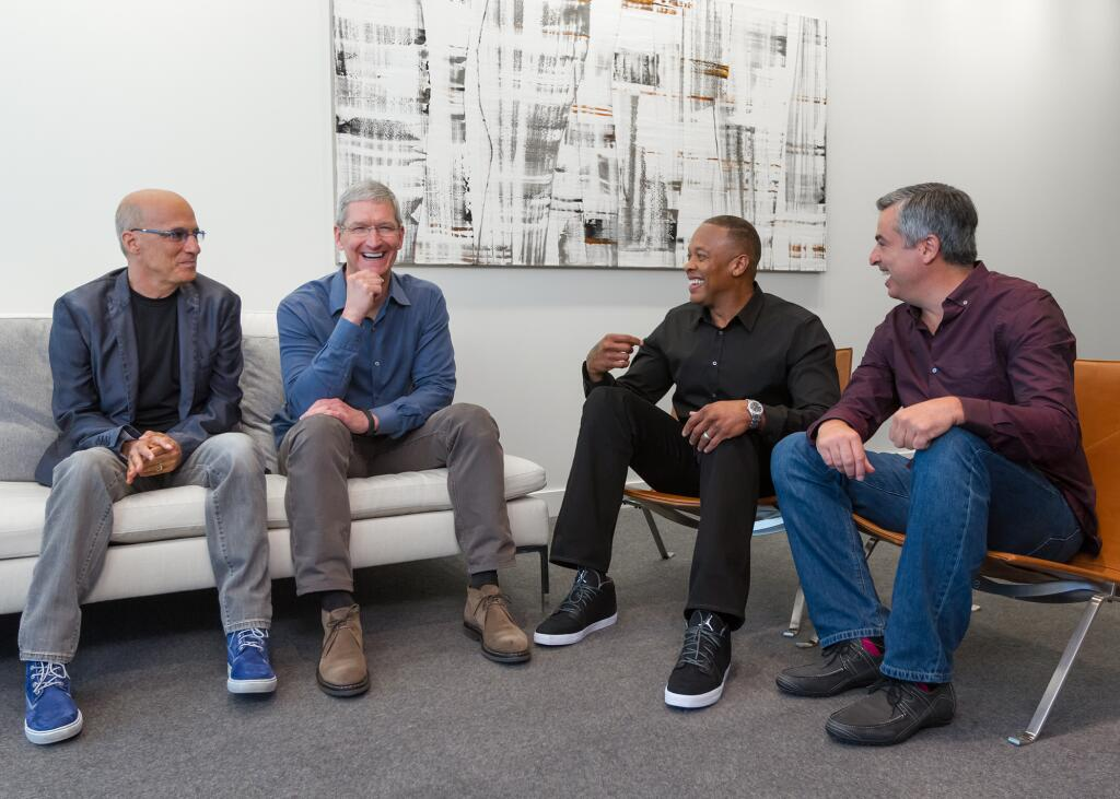 Jimmy Iovine, Tim Cook, Dr. Dre, and Eddy Cue.